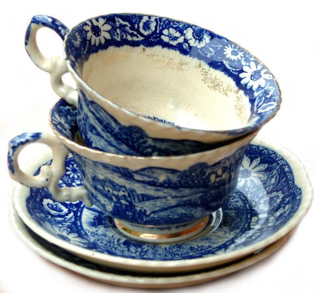 two old teacups stacked on top of one another