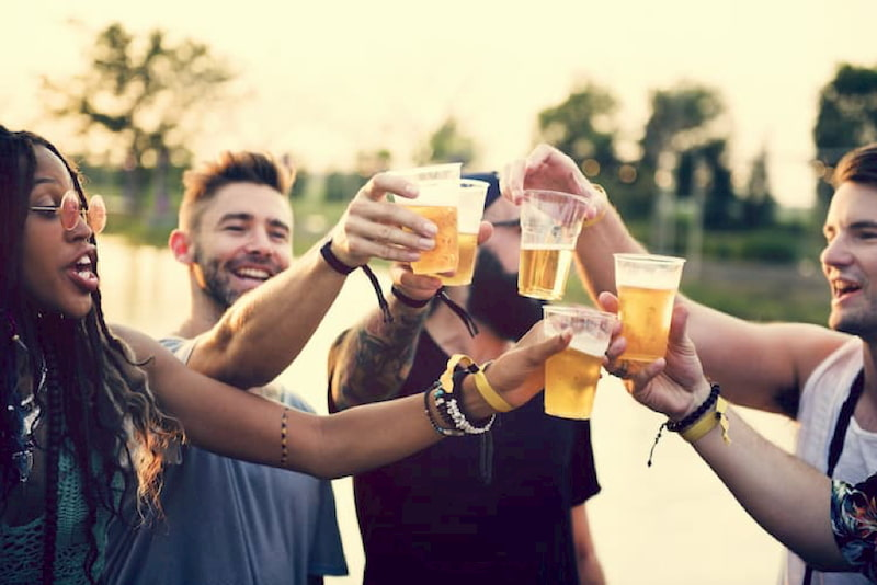 "5 friends ""cheers"" their glasses of beer at the d.c. beerfest"