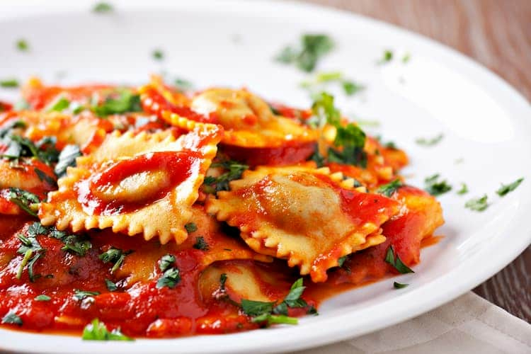 Plate of ravioli with tomato sauce