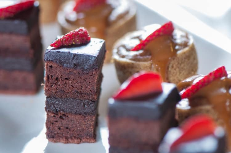 Chocolate cake bites with strawberries on top