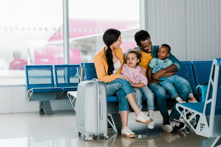 Family sitting in waiting area at airport