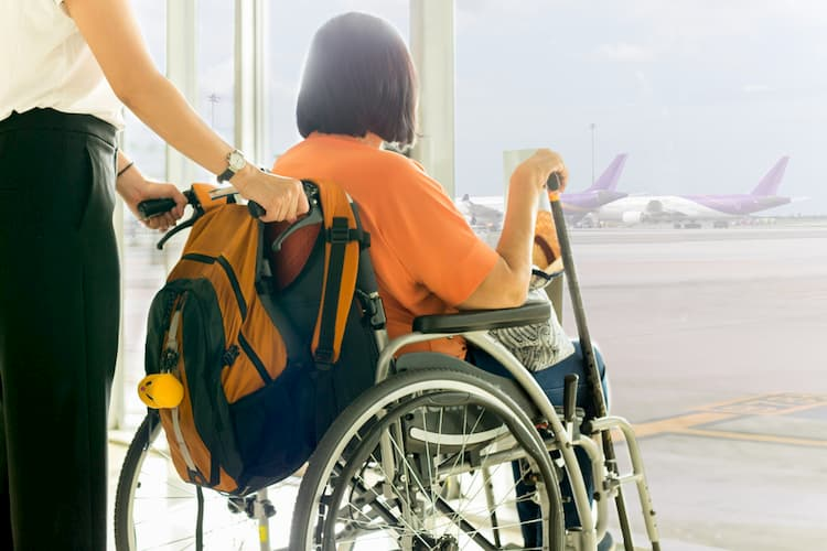 Older woman in wheelchair at airport