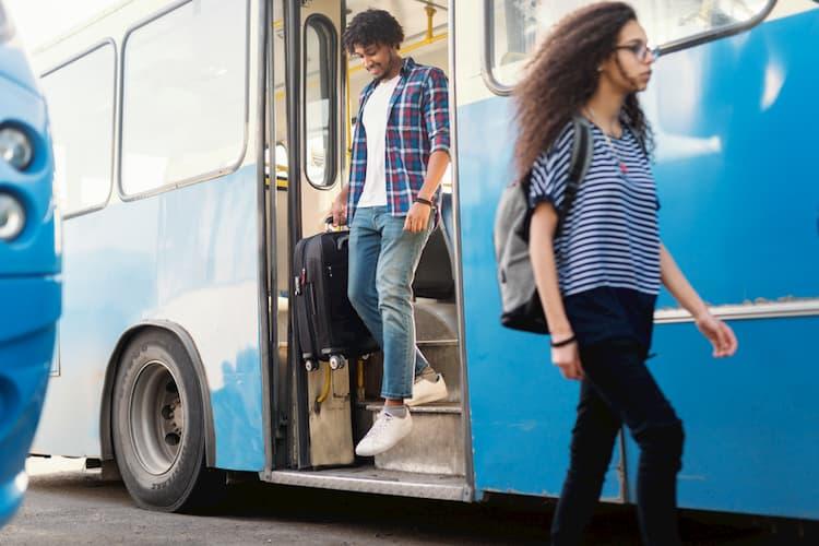 People disembarking bus