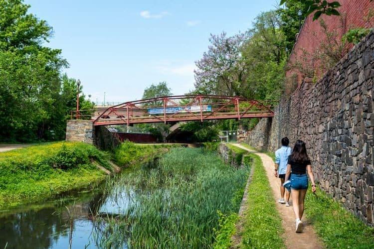 Two women walking by Georgetown canal