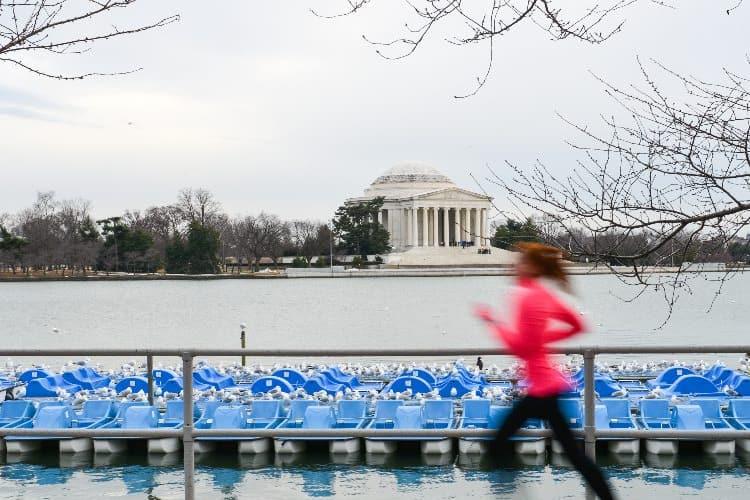 a woman runs past the Jefferson memorial in dc