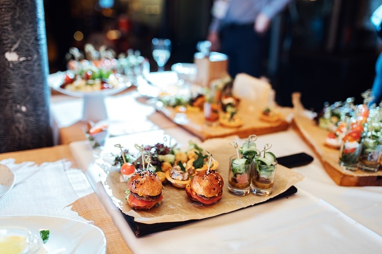 small slider sandwiches on a plate at an upscale restaurant