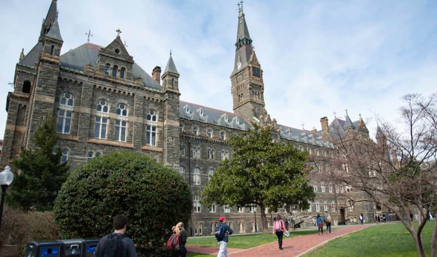 Students walking past the main building at Georgetown University