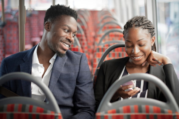 two business partners ride to work on a shuttle bus