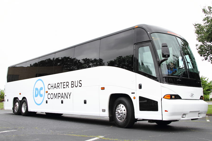 a charter bus with the dc charter bus company logo